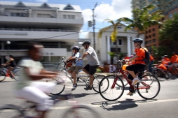 04/25/09 - ALLISON DIAZ/FOR THE MIAMI HERALD -- The main streets of Coconut Grove were shut down allowing only limited car traffic so that cyclists and walkers could safely join in the Orange Bike Parade 2009 as part of Bike Miami Days. Pictured, participants ride up McFarlane Road during the parade. (8 of 9, Coconut Grove)