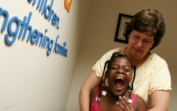 5/02/08 - ALLISON DIAZ/FOR THE MIAMI HERALD -- Trudy Petkocvich holds her daughter Molly, 7, as she laughs at the Kids Hope United office. Molly, Deborah (not pictured) and Katherine (not pictured) were all fostered by Trudy since infancy and later adopted when they were 2 to 4 years old. Trudy also has two biological children, Amy and John Petkovich (not pictured). Most impresive of all, over the past 18 years Trudy has fostered over 280 children and is currently the Foster Parent Liason at Kids Hope United. (Cutler Bay, 4 of 4)