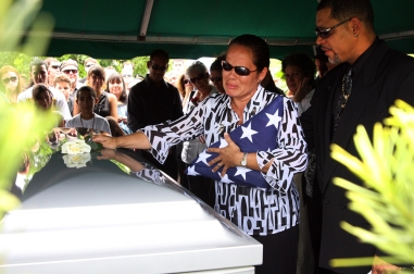 -- 8/15/09 - Allison Diaz / For the Miami Herald -- Family and friends gather at Woodlawn Park Cemetery for the funeral ceremony of Cpl. Christian A. Guzman Rivera, 21, a marine from Homestead, who was killed in Afghanistan. Pictured, Guzman's mother Velma Torres places a rose on her son's casket with her husband Felix by her side. (Homestead, 18 of 22)