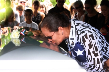 -- 8/15/09 - Allison Diaz / For the Miami Herald -- Family and friends gather at Woodlawn Park Cemetery for the funeral ceremony of Cpl. Christian A. Guzman Rivera, 21, a marine from Homestead, who was killed in Afghanistan. Pictured, Guzman's mother Velma Torres kisses her son's casket. (Homestead, 19 of 22)