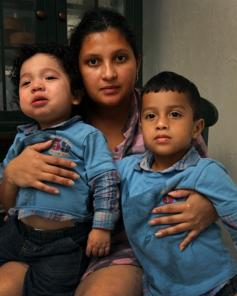 Ana Lissette Portillo, 20, holds her sons, from left, Jordan Orantes Portillo, 20 months, and Walter Orantes Portillo, 4, in their Homestead apartment.