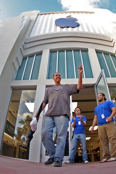 Benjamin Weberman, age 26, of Aventura, holds up his brand new iPhone 4 on Thursday, June 24, 2010, after waiting to be the first in the reserved iPhone 4 line since 10 a.m. the previous day at the Apple store on Miami Beach.