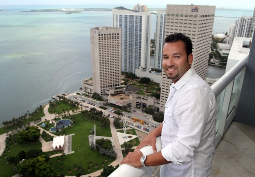Alex Gonzalez, 30, founder of MiamiUrbanLife.com, poses on the balcony of his Downtown Miami condominium on Tuesday, August 31, 2010. Gonzalez started the social networking website in 2007 to help others living and working in the Downtown Miami area to connect and socialize and now has over 2,000 members.