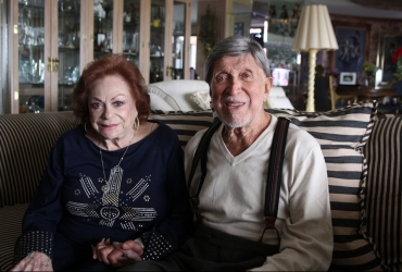 Selma and Ben Z. Grenald pose together in their Miami Shores apartment on Tuesday, April 9, 2013. Grenald was serving in the Navy in May of 1943 when he helped with the capturing of eight German prisoners of war that had escaped from the Queen Mary ship, docked next to his post.